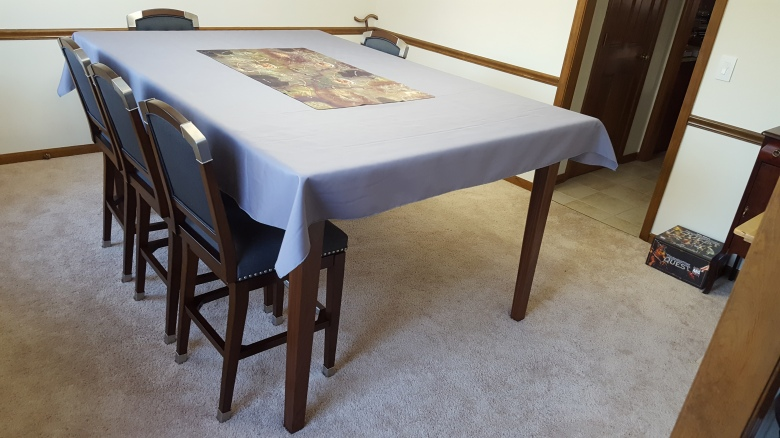 The table with a table cloth.