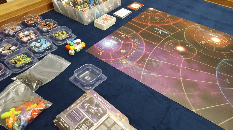 A close-up of the components for the Firefly game inside the table vault.
