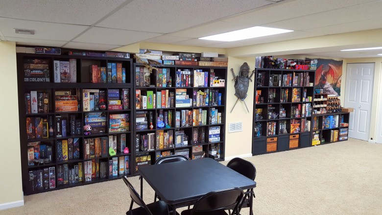 A wall of Kallax shelves filled with games. 4x4 with a 1x4 on top; 5x5; 5x5; 2x4.
