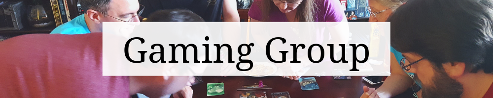 "Page heading graphic that says ""Gaming Group"" on top of a cropped image of people playing a game."
